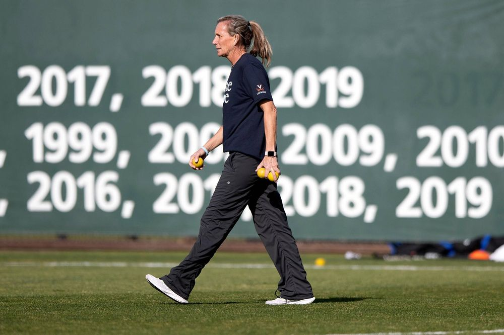STANFORD, California - FEBRUARY 14:  Virginia Cavaliers head coach Julie Myers watches her team before the game against the Stanford Cardinal at Cagan Stadium on February 14, 2020 in Stanford, California. The Virginia Cavaliers defeated the Stanford Cardinal 12-11. (Photo by Jason O. Watson)