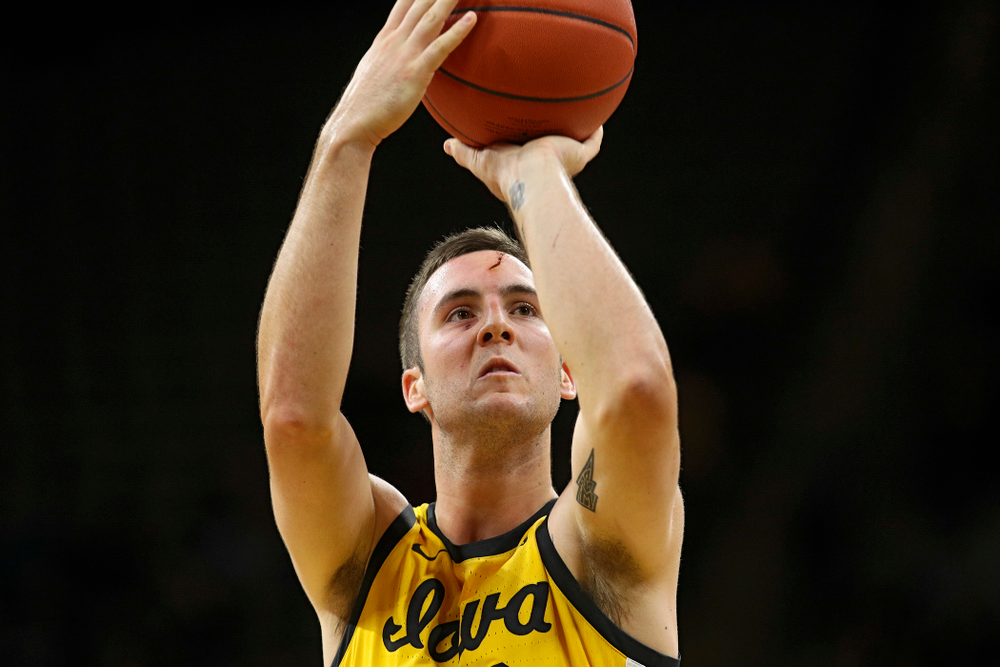 Iowa Hawkeyes guard Connor McCaffery (30) makes a free throw after getting a cut on his forehead during the first half of their game at Carver-Hawkeye Arena in Iowa City on Monday, Nov 11, 2019. (Stephen Mally/hawkeyesports.com)