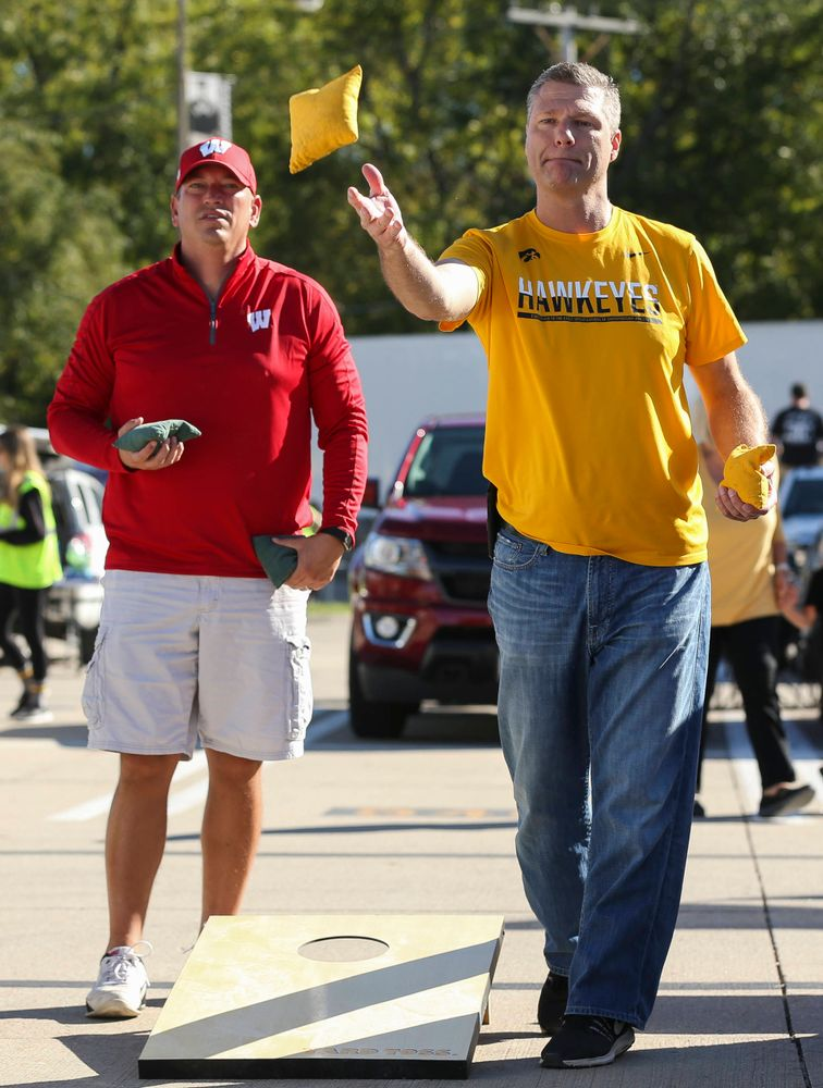 Fans play a game of corn hole outside of Kinnick Stadium before a game against Wisconsin on September 22, 2018.
