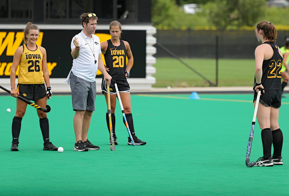 Iowa assistant coach Michael Boal talks with Maddy Murphy (26), Sophie Sunderland (20), and Ellie Flynn (22) as they work on a drill during practice at Grant Field in Iowa City on Thursday, Aug 15, 2019. (Stephen Mally/hawkeyesports.com)