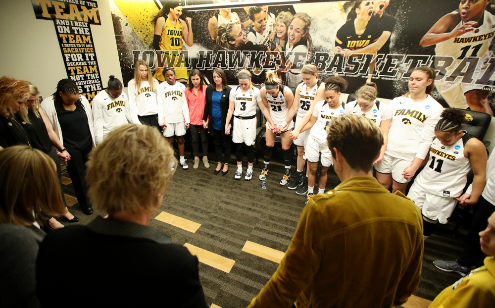 The Iowa Hawkeyes pray as a team in the locker room after winning their second round game in the 2019 NCAA Women's Basketball Tournament at Carver Hawkeye Arena in Iowa City on Sunday, Mar. 24, 2019. (Stephen Mally for hawkeyesports.com)