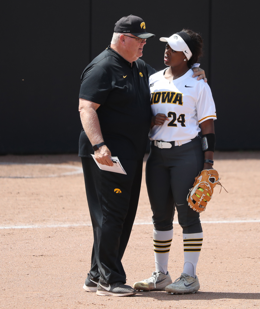 Iowa Hawkeyes DoniRae Mayhew (24) and assistant coach Rick Dillinger against the Ohio State Buckeyes on senior day Sunday, May 5, 2019 at Pearl Field. (Brian Ray/hawkeyesports.com)