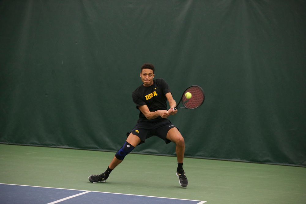 Iowa's Oliver Okonkwo returns a ball during the Iowa men's tennis meet vs VCU  on Saturday, February 29, 2020 at the Hawkeye Tennis and Recreation Complex. (Lily Smith/hawkeyesports.com)