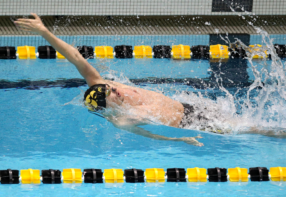 Iowa's Will Scott swims the men's 50 yard backstroke event during their meet at the Campus Recreation and Wellness Center in Iowa City on Friday, February 7, 2020. (Stephen Mally/hawkeyesports.com)
