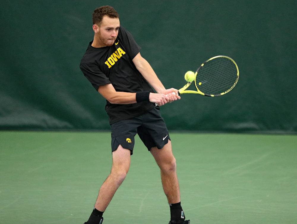 Iowa's Kareem Allaf hits a shot during their doubles match against Marquette at the Hawkeye Tennis and Recreation Complex in Iowa City on Saturday, January 25, 2020. (Stephen Mally/hawkeyesports.com)