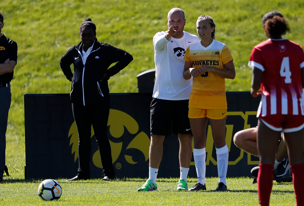 Iowa Hawkeyes assistant coach Rade Tanaskovic gives instructions to Iowa Hawkeyes midfielder Isabella Blackman (6) before a free kick during a game against Indiana at the Iowa Soccer Complex on September 23, 2018. (Tork Mason/hawkeyesports.com)