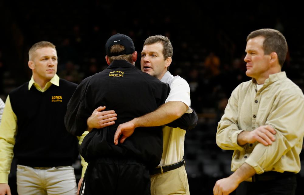 Iowa's senior Brandon Sorensen hugs head coach Tom Brands following their meet against Northwestern
