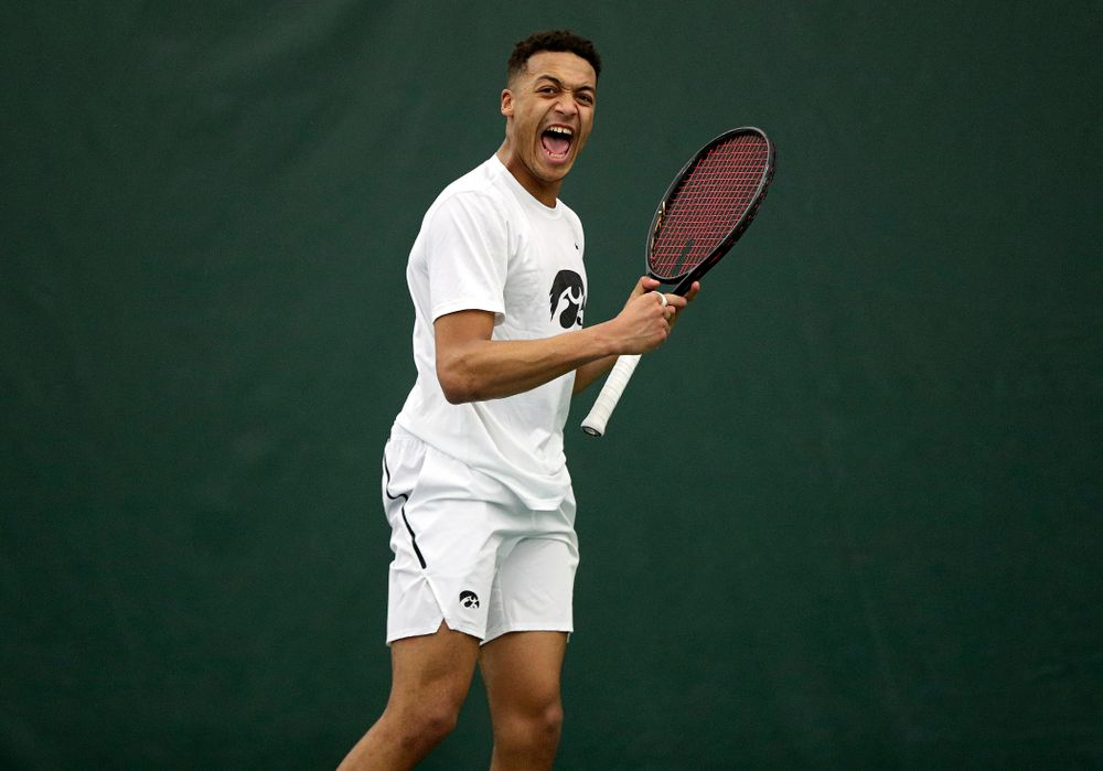 Iowa's Oliver Okonkwo celebrates a point during his singles match at the Hawkeye Tennis and Recreation Complex in Iowa City on Sunday, February 16, 2020. (Stephen Mally/hawkeyesports.com)