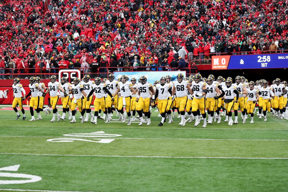 The Iowa Hawkeyes swarm onto the field against the Nebraska Cornhuskers Friday, November 29, 2019 at Memorial Stadium in Lincoln, Neb. (Brian Ray/hawkeyesports.com)