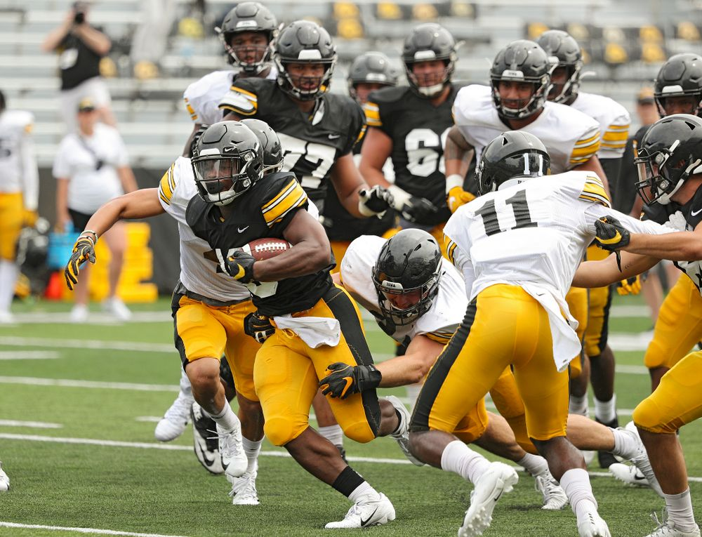 Iowa Hawkeyes running back Mekhi Sargent (10) on a run during Fall Camp Practice No. 8 at Kids Day at Kinnick Stadium in Iowa City on Saturday, Aug 10, 2019. (Stephen Mally/hawkeyesports.com)
