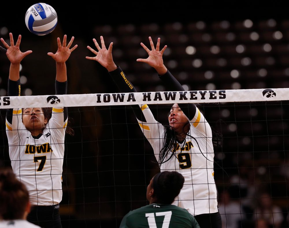 Iowa Hawkeyes setter Gabrielle Orr (7) and middle blocker Amiya Jones (9) against the Michigan State Spartans Friday, September 21, 2018 at Carver-Hawkeye Arena. (Brian Ray/hawkeyesports.com)
