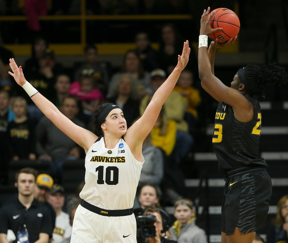 Iowa Hawkeyes center Megan Gustafson (10) tries to block a shot by Missouri Tigers guard Amber Smith (23) during the third quarter of their second round game in the 2019 NCAA Women's Basketball Tournament at Carver Hawkeye Arena in Iowa City on Sunday, Mar. 24, 2019. (Stephen Mally for hawkeyesports.com)