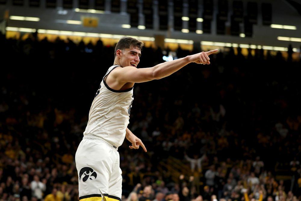 Iowa Hawkeyes forward Luka Garza (55) reacts after a dunk against Penn State Saturday, February 29, 2020 at Carver-Hawkeye Arena. (Brian Ray/hawkeyesports.com)