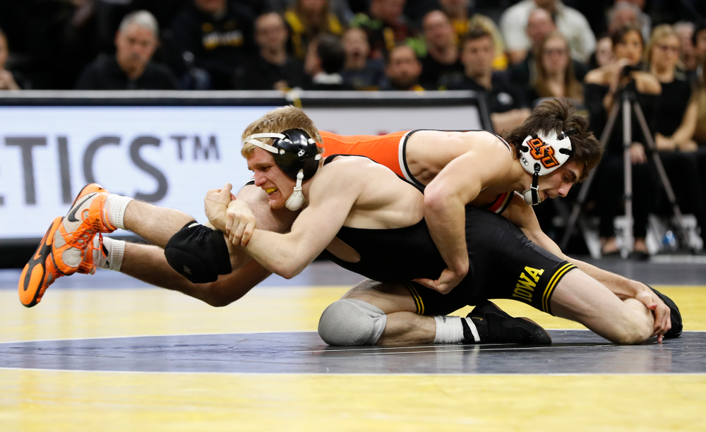 Iowa's Phillip Laux wrestles Oklahoma State's Kaid Brock at 133 pounds