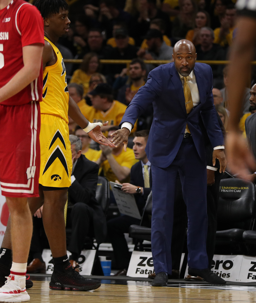 Iowa Hawkeyes assistant coach Andrew Francis against the Wisconsin Badgers Friday, November 30, 2018 at Carver-Hawkeye Arena. (Brian Ray/hawkeyesports.com)