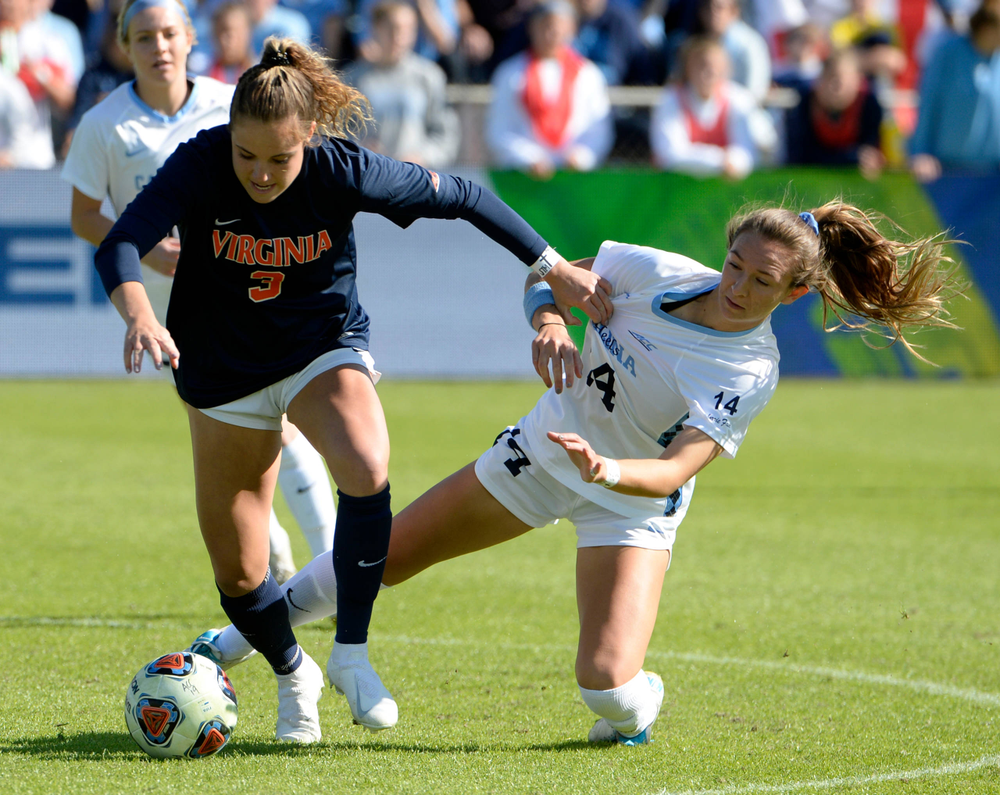 Virginia's Ashlynn Serepca (3) knocks over North Carolina's Bridgette Andrzejewski (4) during the 2019 ACC Women?s Soccer Championship at WakeMed Soccer Park in Cary, N.C., Sunday Nov. 10, 2019. (Photo by Sara D. Davis, the ACC)