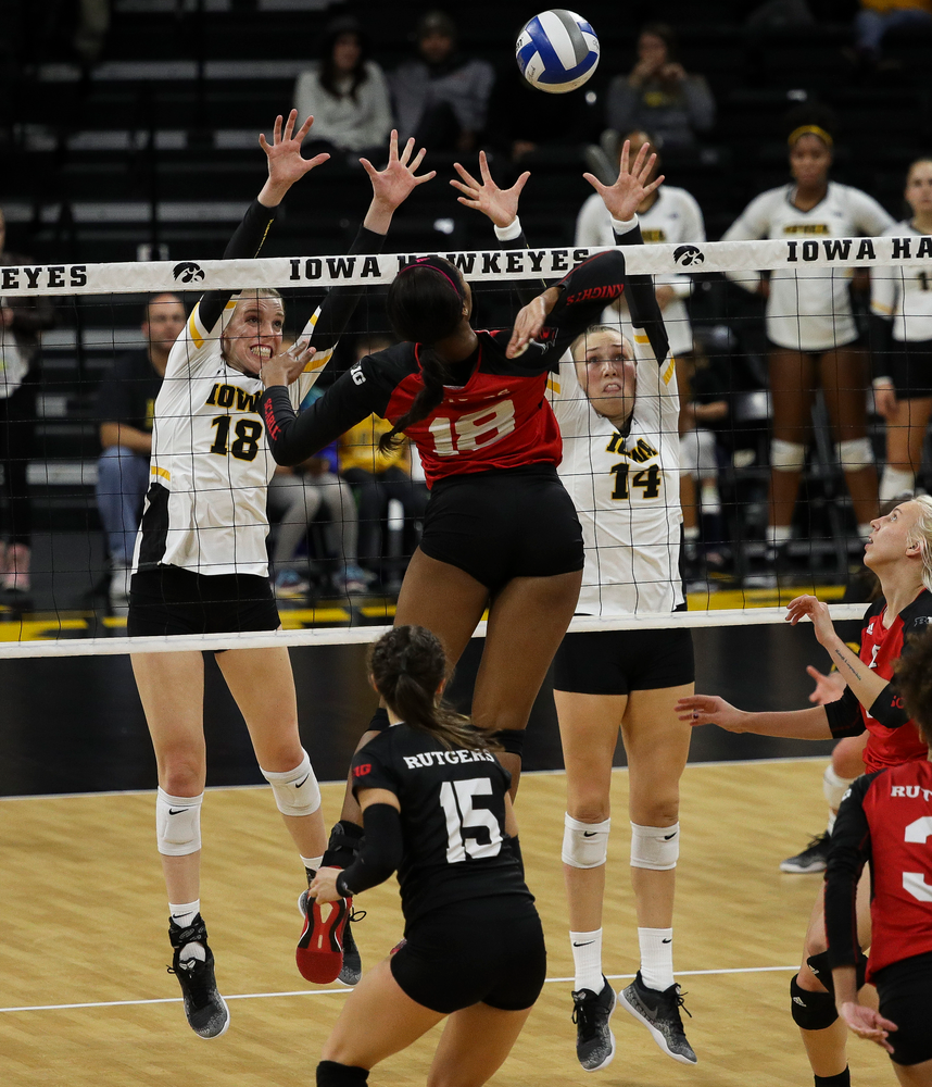 Iowa Hawkeyes middle blocker Hannah Clayton (18) and Iowa Hawkeyes outside hitter Cali Hoye (14) go up for a block during a match against Rutgers at Carver-Hawkeye Arena on November 2, 2018. (Tork Mason/hawkeyesports.com)
