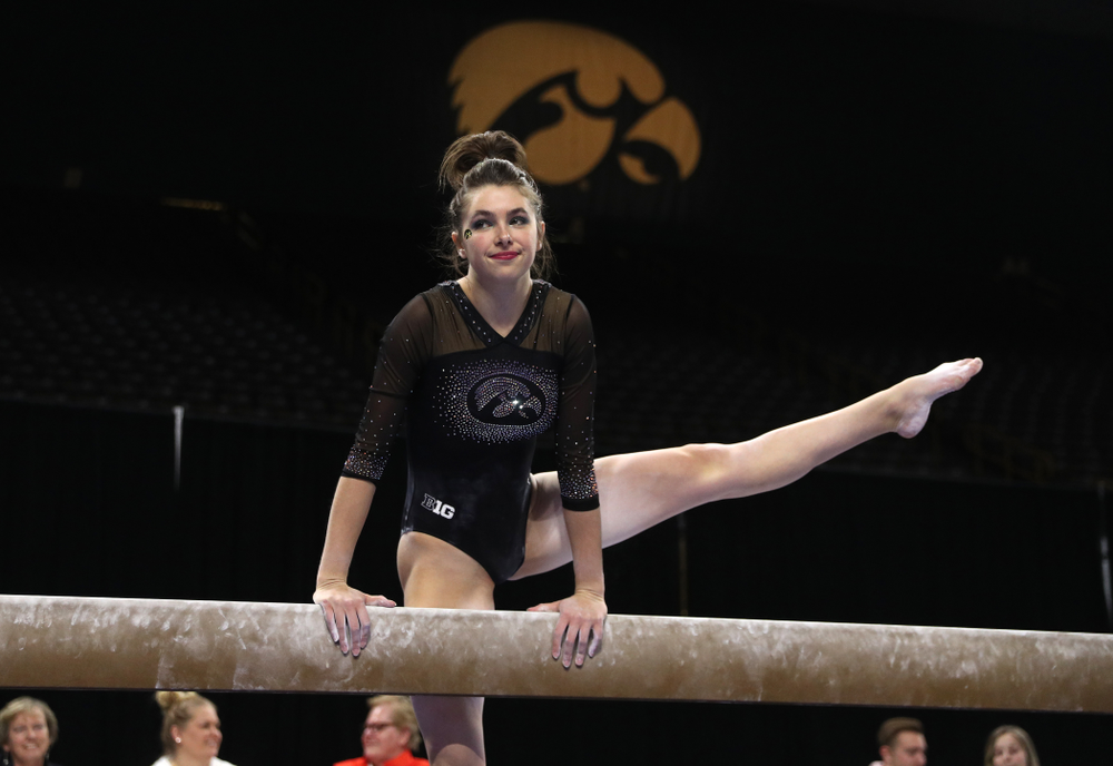 Iowa's Bridget Killian competes on the beam against Michigan Friday, February 14, 2020 at Carver-Hawkeye Arena. (Brian Ray/hawkeyesports.com)