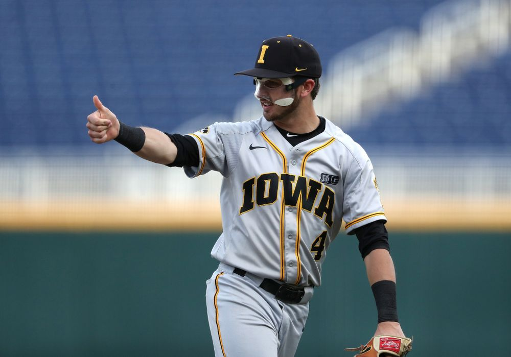 Iowa Hawkeyes Tanner Wetrich (16) and infielder Mitchell Boe (4) celebrate after tuning a double play against the Indiana Hoosiers in the first round of the Big Ten Baseball Tournament Wednesday, May 22, 2019 at TD Ameritrade Park in Omaha, Neb. (Brian Ray/hawkeyesports.com)