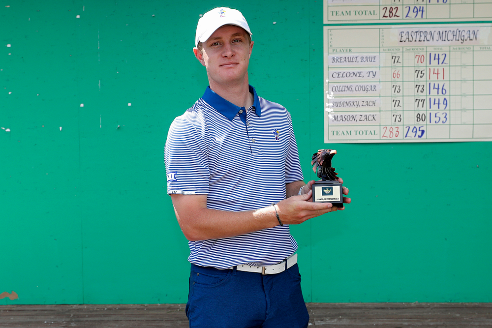 Kansas' Charlie Hillier holds his runner-up trophy after the third round of the Hawkeye Invitational at Finkbine Golf Course in Iowa City on Sunday, Apr. 21, 2019. (Stephen Mally/hawkeyesports.com)