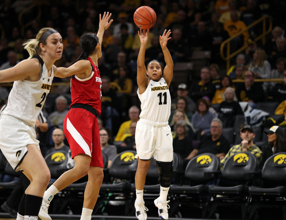 Iowa Hawkeyes guard Tania Davis (11) knocks down a three point basket against the Nebraska Cornhuskers Thursday, January 3, 2019 at Carver-Hawkeye Arena. (Brian Ray/hawkeyesports.com)