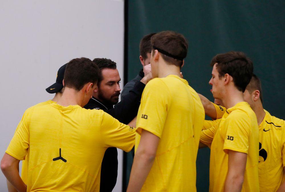 Iowa Head Coach Ross Wilson gathers his team during their match against Creighton