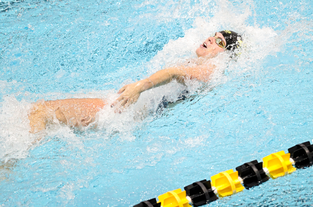 Iowa's Kennedy Gilbertson swims the women's 50 yard backstroke event during their meet at the Campus Recreation and Wellness Center in Iowa City on Friday, February 7, 2020. (Stephen Mally/hawkeyesports.com)