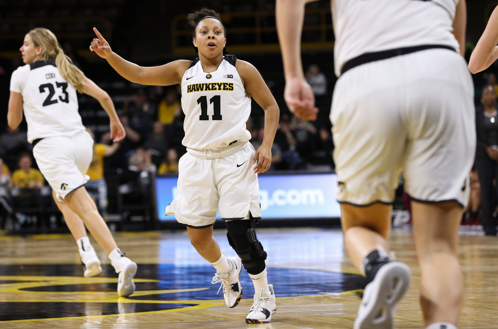 Iowa Hawkeyes guard Tania Davis (11) gives defensive signals during a game against North Carolina Central at Carver-Hawkeye Arena on November 17, 2018. (Tork Mason/hawkeyesports.com)