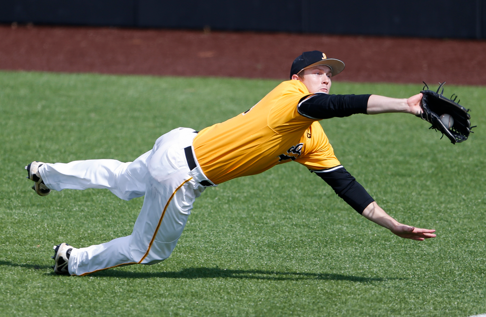Iowa Hawkeyes outfielder Robert Neustrom (44) makes a diving catch during a game against Evansville at Duane Banks Field on March 18, 2018. (Tork Mason/hawkeyesports.com)