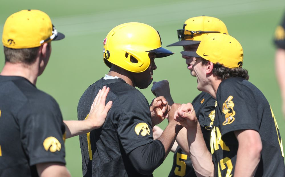 Iowa Hawkeyes infielder Lorenzo Elion (1) celebrates with his teammates after scoring during game two against UC Irvine Saturday, May 4, 2019 at Duane Banks Field. (Brian Ray/hawkeyesports.com)