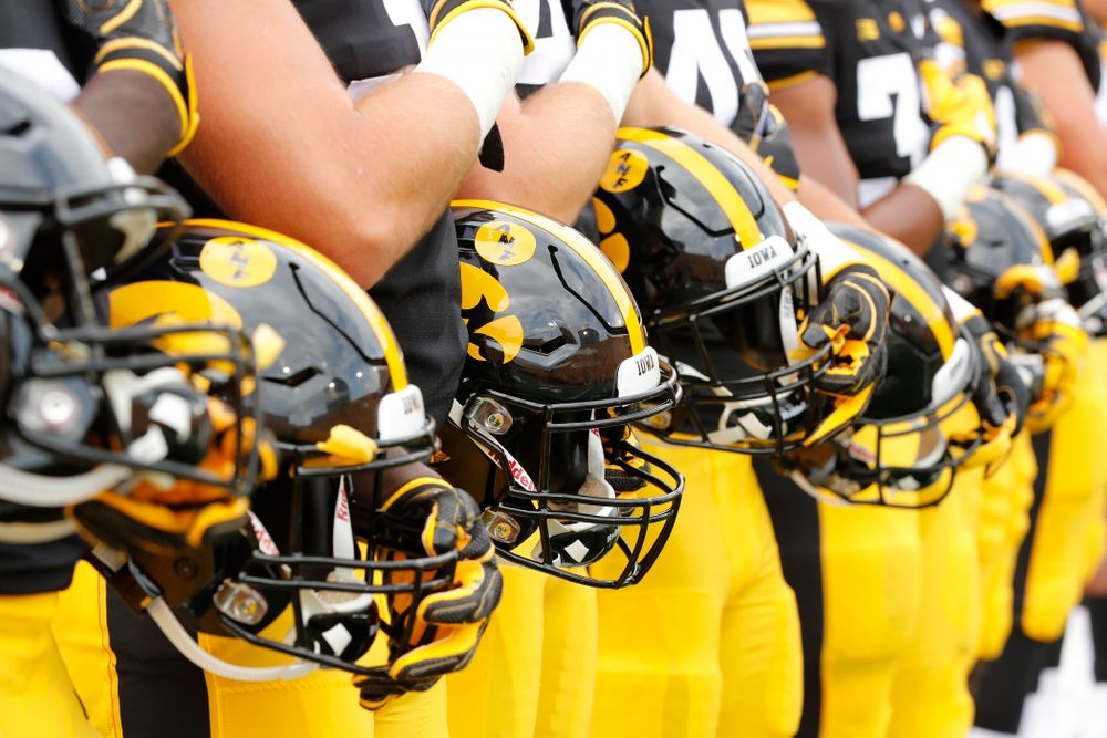 The Iowa Hawkeyes stand for the National Anthem against the Northern Illinois Huskies Saturday, September 1, 2018 at Kinnick Stadium. (Brian Ray/hawkeyesports.com)