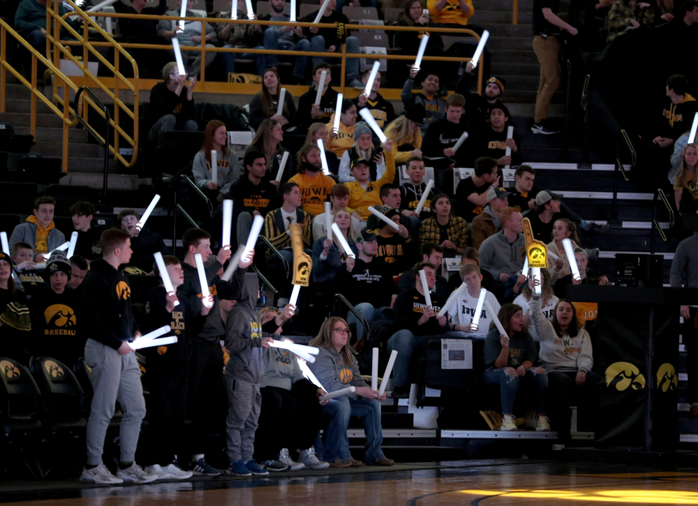 Fans wave glow sticks before the Iowa Hawkeyes game against the Michigan Wolverines Friday, January 17, 2020 at Carver-Hawkeye Arena. (Brian Ray/hawkeyesports.com)