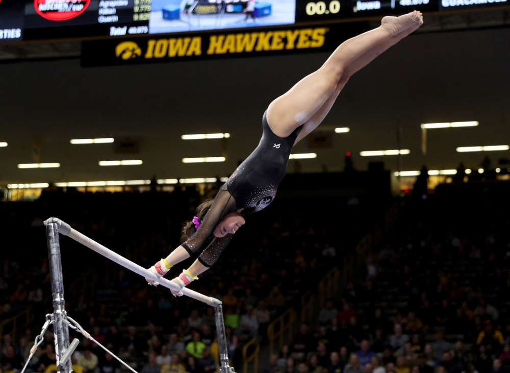 Iowa's Carina Tolan competes on the bars against Michigan Friday, February 14, 2020 at Carver-Hawkeye Arena. (Brian Ray/hawkeyesports.com)