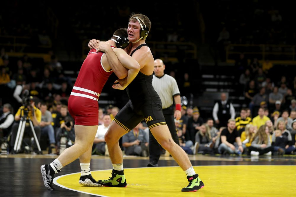 IowaÕs Jacob Warner wrestles WisconsinÕs Taylor Watkins at 197 pounds Sunday, December 1, 2019 at Carver-Hawkeye Arena. Warner won the match 5-2. (Brian Ray/hawkeyesports.com)