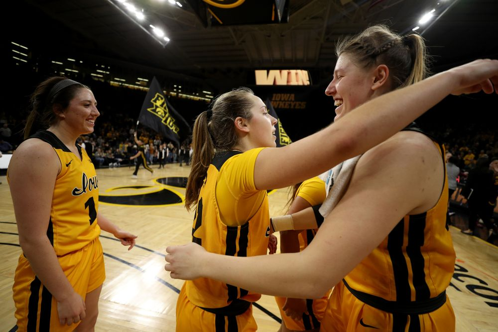Iowa Hawkeyes guard Kathleen Doyle (22) and forward/center Monika Czinano  against the Minnesota Golden Gophers Thursday, February 27, 2020 at Carver-Hawkeye Arena. (Brian Ray/hawkeyesports.com)