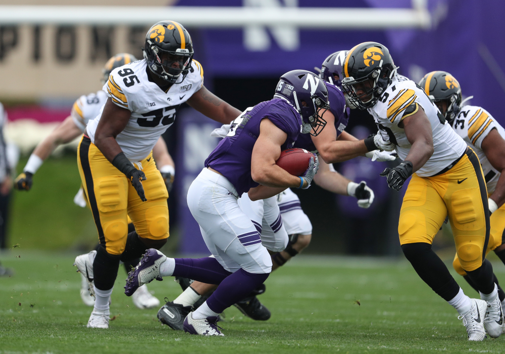 Iowa Hawkeyes defensive lineman Cedrick Lattimore (95) and defensive end Chauncey Golston (57) against the Northwestern Wildcats Saturday, October 26, 2019 at Ryan Field in Evanston, Ill. (Brian Ray/hawkeyesports.com)