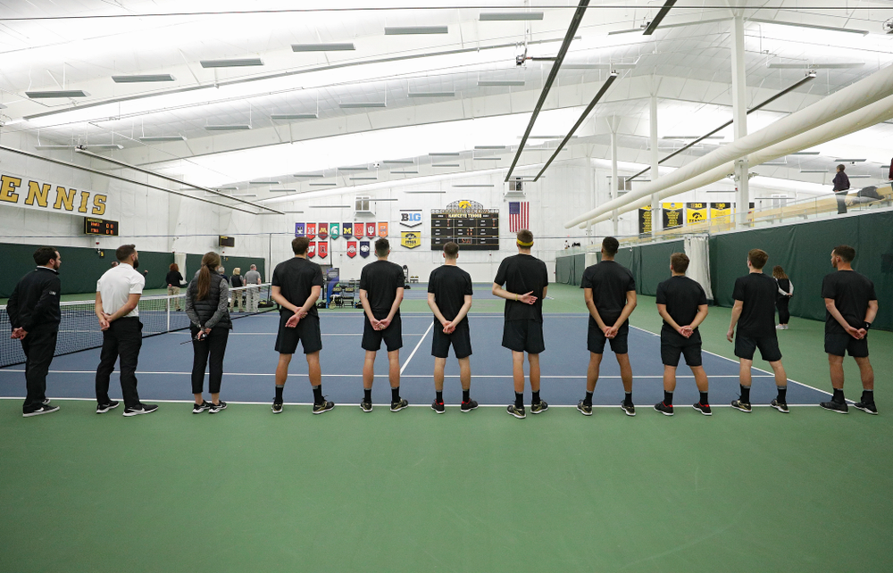 The Hawkeyes stand for the National Anthem before their match at the Hawkeye Tennis and Recreation Complex in Iowa City on Thursday, January 16, 2020. (Stephen Mally/hawkeyesports.com)