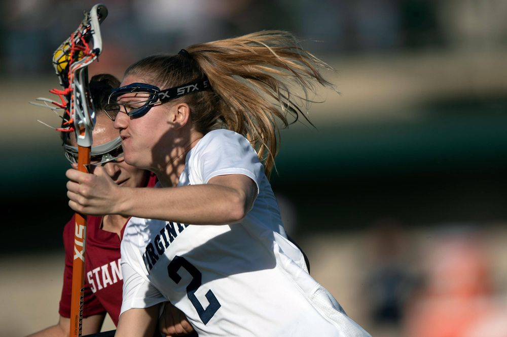 STANFORD, California - FEBRUARY 14:  Virginia Cavaliers midfield Sammy Mueller (2) is defended by Stanford Cardinal defense Kyra Pelton (8) during the first half at Cagan Stadium on February 14, 2020 in Stanford, California. The Virginia Cavaliers defeated the Stanford Cardinal 12-11. (Photo by Jason O. Watson)