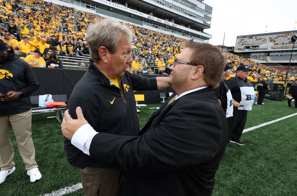 University of Iowa President Bruce Harreld talks with Hawkeye Marching Band Director Eric Bush before the Iowa Hawkeyes game against Middle Tennessee State Saturday, September 28, 2019 at Kinnick Stadium. (Brian Ray/hawkeyesports.com)