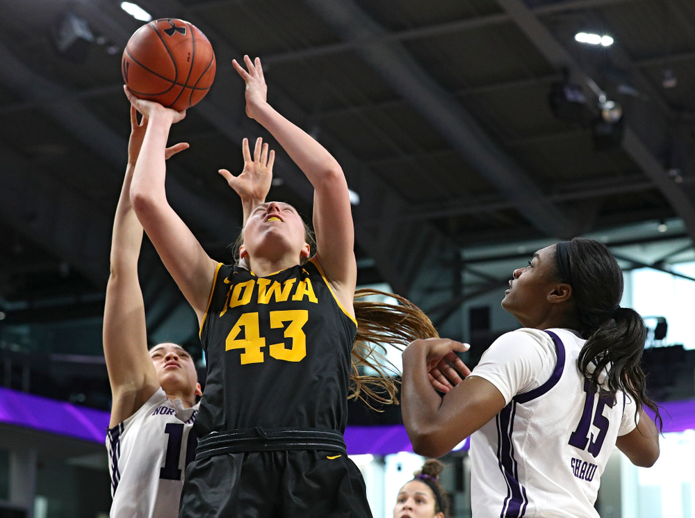Iowa Hawkeyes forward Amanda Ollinger (43) makes a basket during the third quarter of their game at Welsh-Ryan Arena in Evanston, Ill. on Sunday, January 5, 2020. (Stephen Mally/hawkeyesports.com)