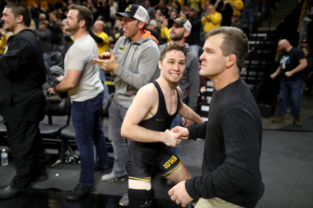 IowaÕs Spencer Lee cheers on teammate Austin DeSanto as he wrestles WisconsinÕs  Seth Gross at 133 pounds Sunday, December 1, 2019 at Carver-Hawkeye Arena. DeSanto won the match 6-2. (Brian Ray/hawkeyesports.com)
