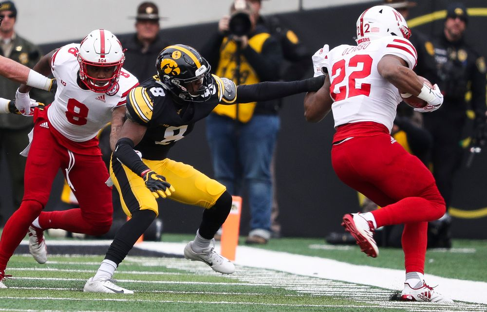 Iowa Hawkeyes defensive back Matt Hankins (8) pushes the ballcarrier out of bounds during a game against Nebraska at Kinnick Stadium on November 23, 2018. (Tork Mason/hawkeyesports.com)