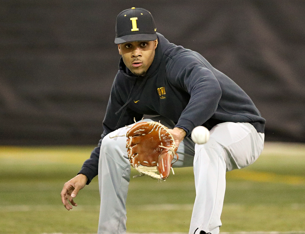 Iowa Hawkeyes infielder Lorenzo Elion (1) fields a ball during practice at the Hansen Football Performance Center in Iowa City on Friday, January 24, 2020. (Stephen Mally/hawkeyesports.com)