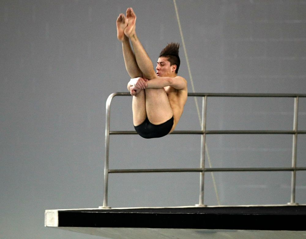Iowa's Jonatan Posligua competes in the platform diving event during their meet at the Campus Recreation and Wellness Center in Iowa City on Friday, February 7, 2020. (Stephen Mally/hawkeyesports.com)