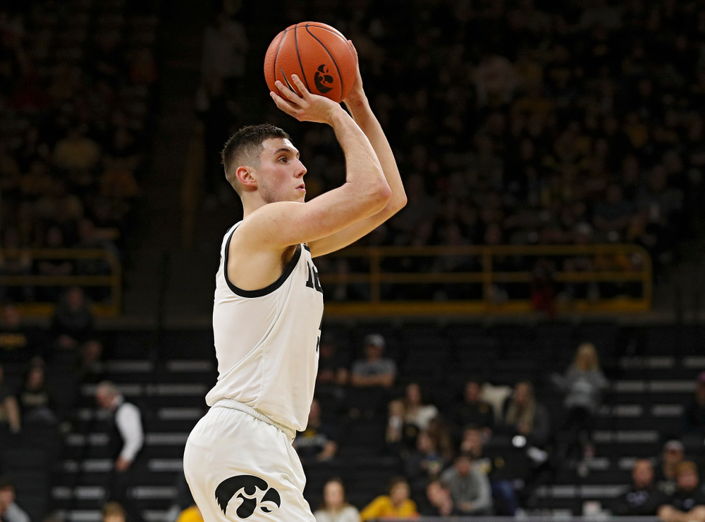 Iowa Hawkeyes guard CJ Fredrick (5) makes a 3-pointer during the second half of their game at Carver-Hawkeye Arena in Iowa City on Sunday, Nov 24, 2019. (Stephen Mally/hawkeyesports.com)