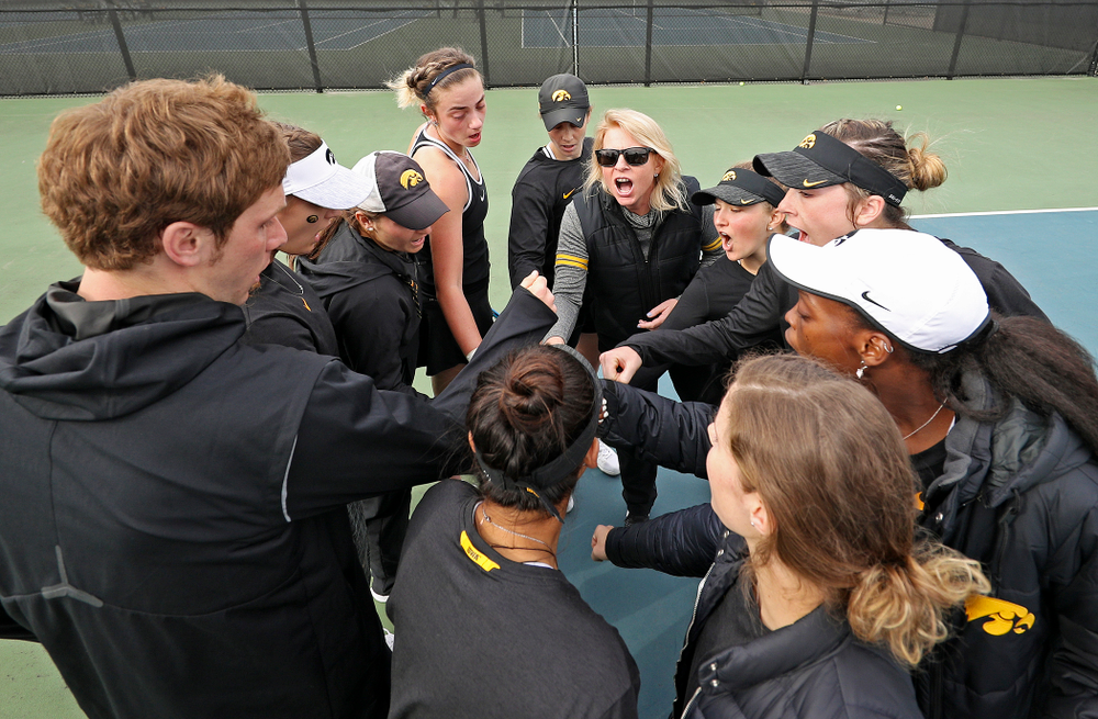 The Iowa Hawkeye huddle after their match against Rutgers at the Hawkeye Tennis and Recreation Complex in Iowa City on Friday, Apr. 5, 2019. (Stephen Mally/hawkeyesports.com)