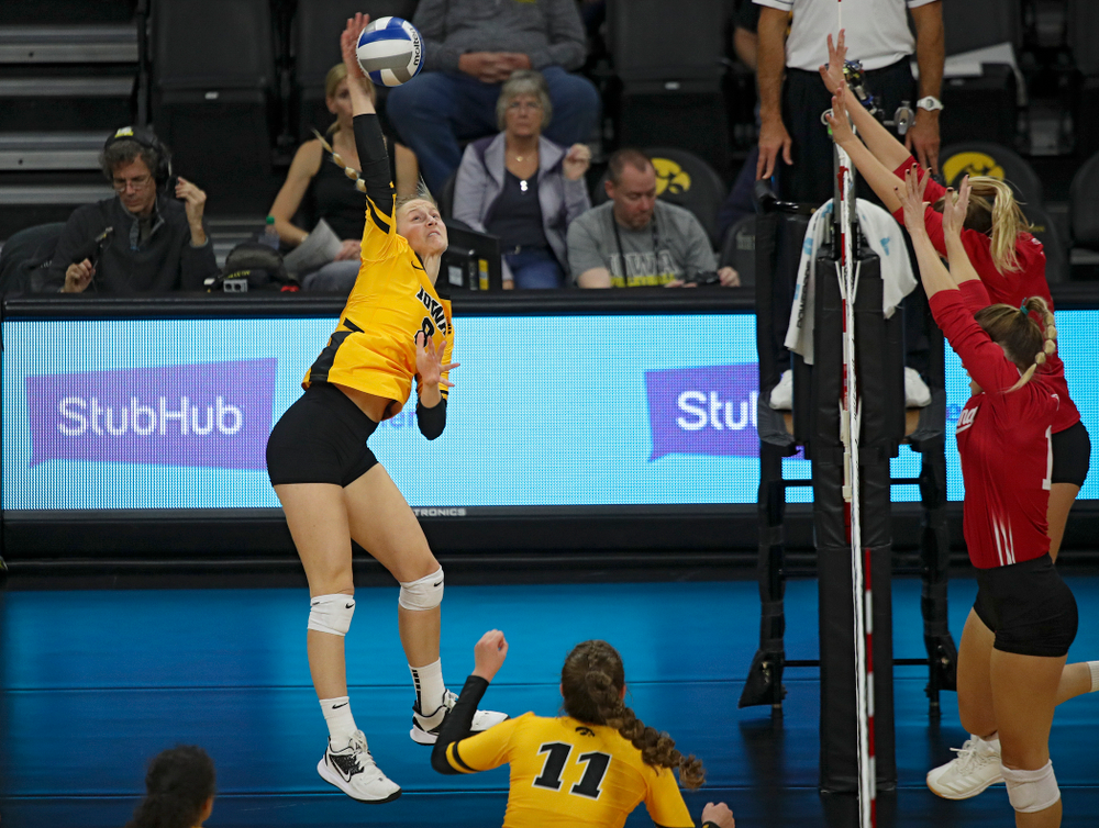 Iowa's Kyndra Hansen (8) lines up a shot during their match at Carver-Hawkeye Arena in Iowa City on Sunday, Oct 20, 2019. (Stephen Mally/hawkeyesports.com)