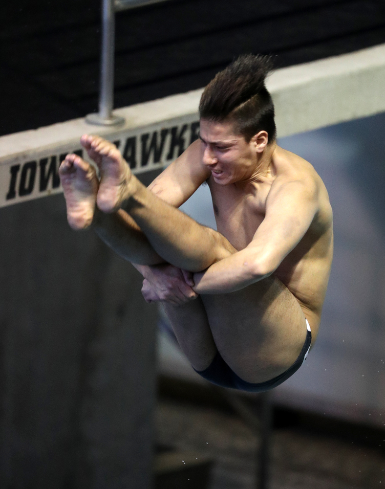Iowa's Jonatan Posligua competes on the 1 meter springboard during a double dual against Wisconsin and Northwestern Saturday, January 19, 2019 at the Campus Recreation and Wellness Center. (Brian Ray/hawkeyesports.com)