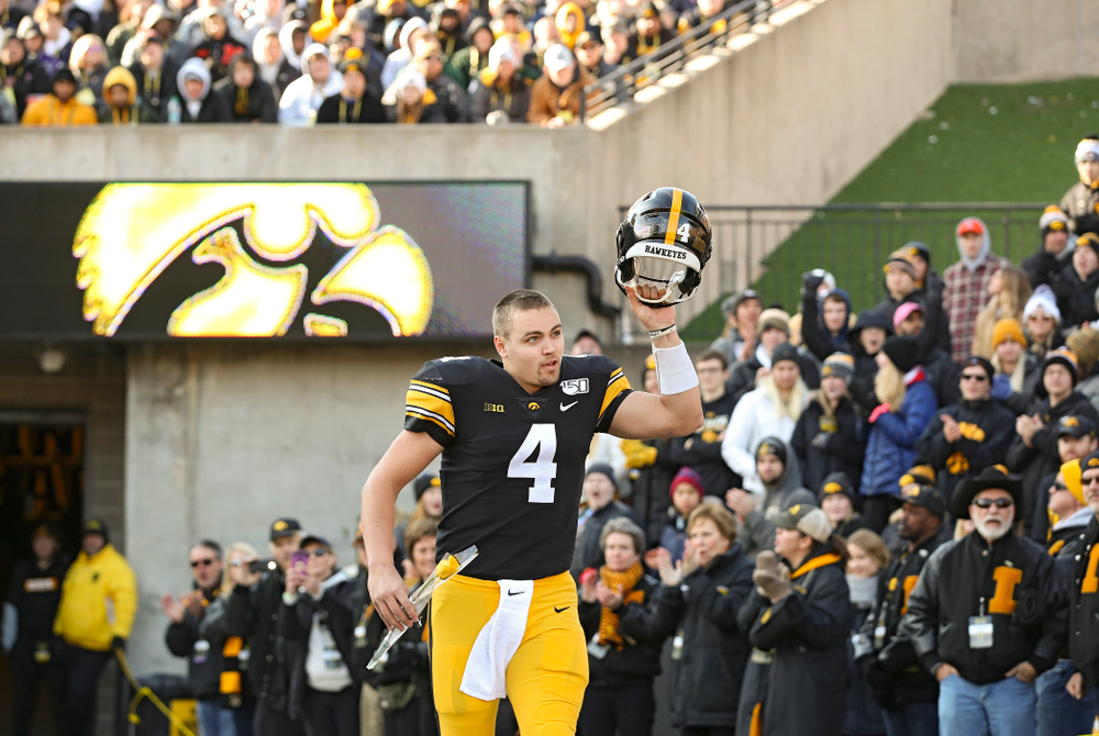 Iowa Hawkeyes quarterback Nate Stanley (4) is acknowledged on senior day before their game at Kinnick Stadium in Iowa City on Saturday, Nov 23, 2019. (Stephen Mally/hawkeyesports.com)