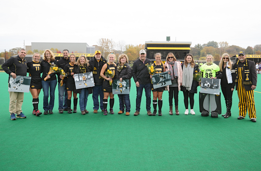 Iowa's Katie Birch (11), Isabella Solaroli (16), Ryley Miller (19), Sophie Sunderland (20), Leslie Speight (96) are honored on the field with their family for Senior Day before their game at Grant Field in Iowa City on Saturday, Oct 26, 2019. (Stephen Mally/hawkeyesports.com)